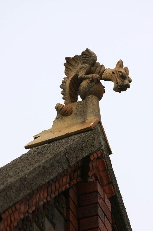 Mischievous dragon overlookign Moore Street. Credit - Jonathanmbradshaw