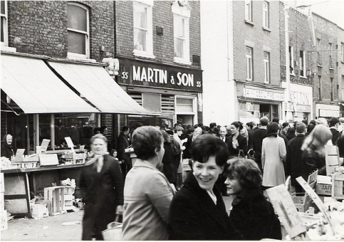 A view of Moore Street, in pre Ilac Centre days, from the 1950s with no. 55 visible in top left corner. Credit -