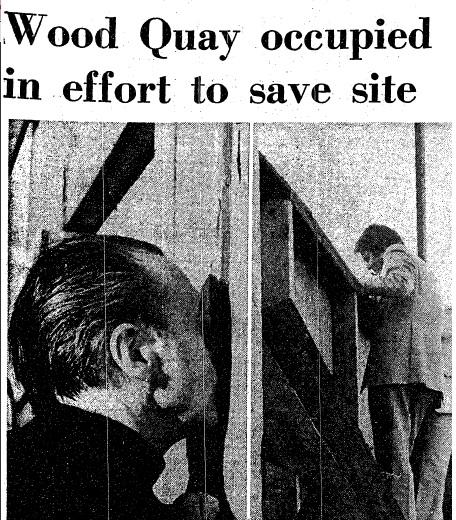 F.X Martin peeps through the fence at Wood Quay. (The Irish Times, 2 June 1979)