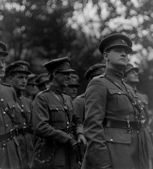 A now iconic image of Michael Collins, taking at the funeral of Arthur Griffith.