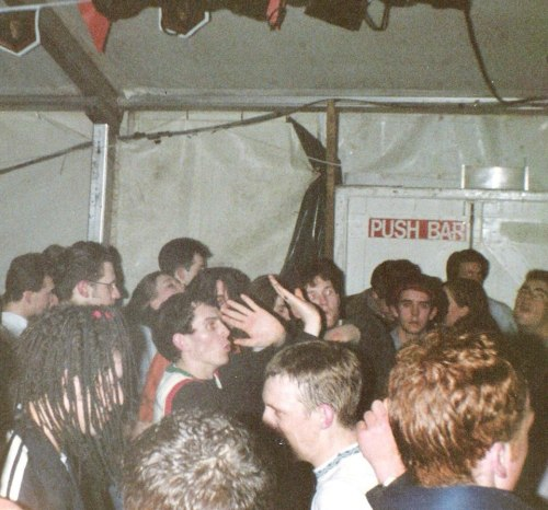 Liam with raised hands at The Shamen gig , UCD Rag Ball in March 1991 - Photo Paul O'Sullivan. via Where Were You?