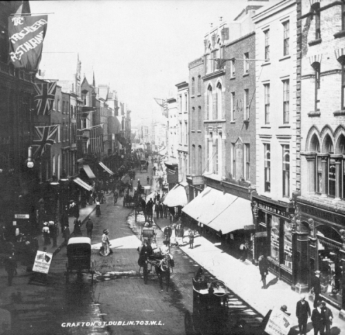 Union flags can be seen on Grafton Street, in this photograph taken around the time of the last Royal Visit to a British Dublin, 1911.
