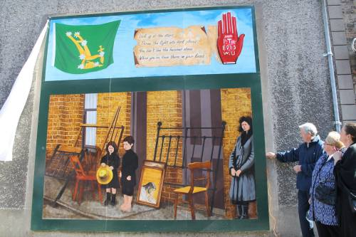 The mural commemorating the evictions. This mural is based on a real newspaper image from the time.