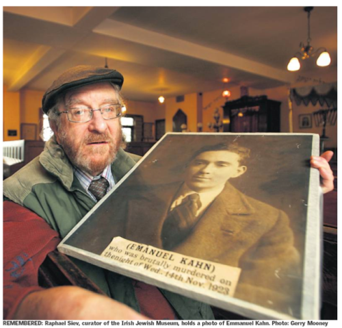 Raphael Siev (RIP), former curator of the Jewish Museum, with a picture of Ernest Kahn. Credit - The Sunday Independent (24 June 2007)