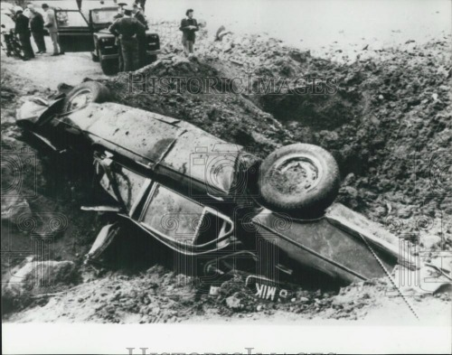 Scene after land mine destroys the car of Christopher. Credit - keptelenseg.hu