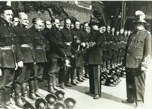 Captain Joe Connolly, Chief Officer Dublin Fire Brigade,presenting the brigade with the new 'electric shockproof' helmets to replace the brass helmet worn since the 1860s. (Thanks to Las Fallon)
