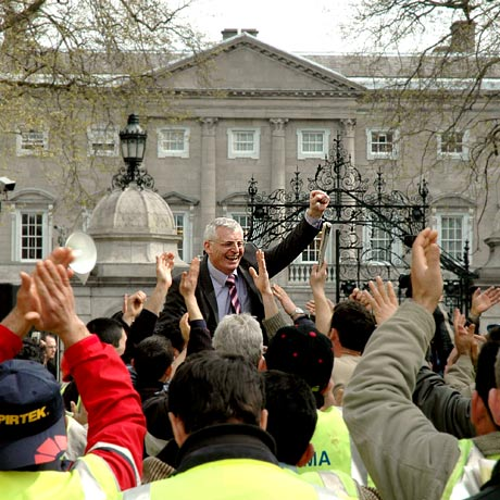 Joe Higgins and GAMA workers at the gates of the Dáil.