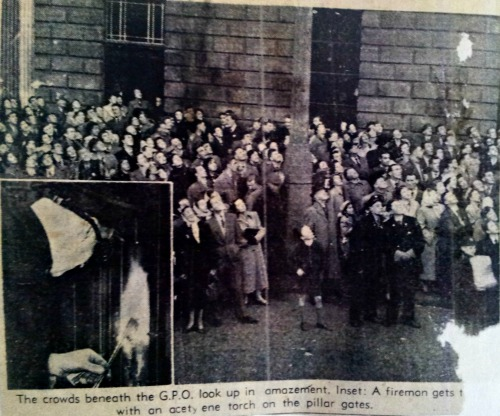A crowd gathers below the Nelson Pillar to observe the student occupation.