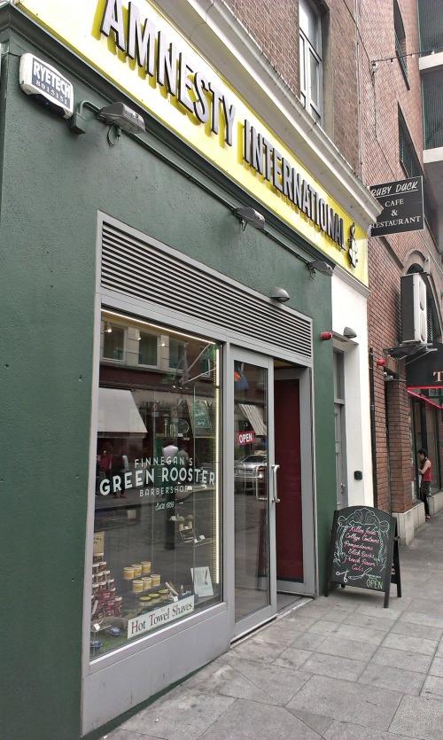Tattooist takes over Amnesty Cafe. Credit - Sam