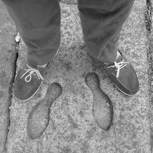 Standing beside the very small footprints of King George IV.
