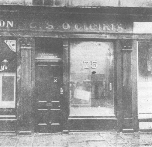 Thomas Clarke's Tobacco shop and newsagents, notice the Irish language signage.