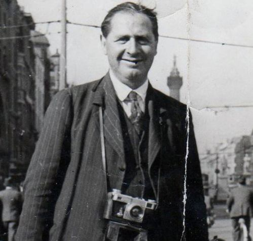Arthur Fields standing on O'Connell Bridge with the Nelson Pillar visible in the background.
