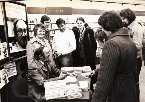 Eamonn MacThomáis signing copies of a later book in Easons (Image from the Facebook page Eamonn Mac Thomais, A legendary Dubliner)