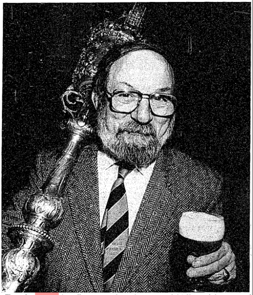 A 1988 image of Eamonn MacThomáis, then a well-known tour guide and writer in the city, clutching the ceremonial mace of the Old Irish House of Lords!