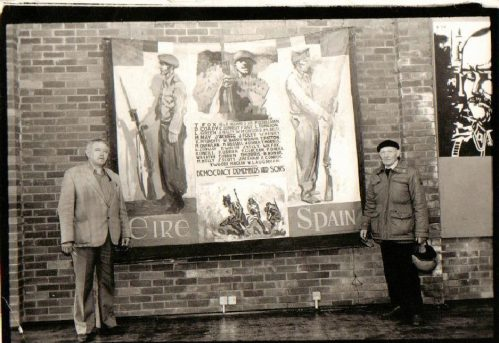 Two Irish veterans of the International Brigade, Michael O'Riordan and Bob Doyle, with the banner now contained in the National Museum of Ireland (Image: AFA Ireland Facebook)
