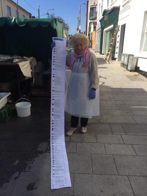 Vera with printed out Facebook comments. Picture credit - Don Mc Manus.