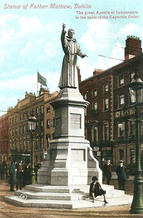 A historic postcard showing the monument.