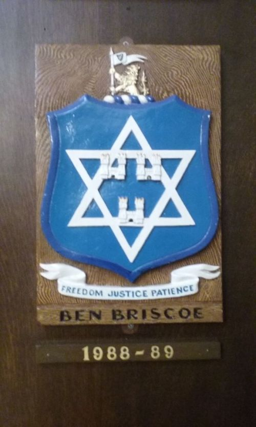 The personal coat of arms of Ben Briscoe, incorporating the Star of David.