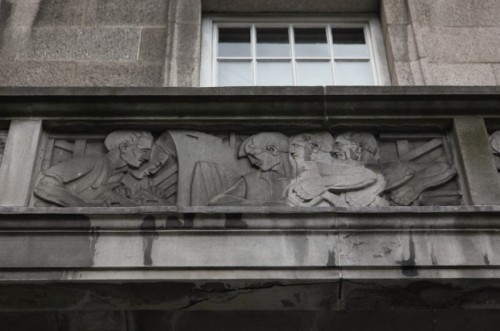 The excellent Built Dublin has photographed the bas-reliefs. See http://builtdublin.com/balcony-23-kildare-street-dublin-2/ (Image Credit: Lisa Cassidy, BuiltDublin.com)