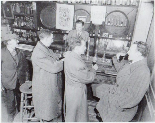 According to Rareirishstuff.com, this is an image of The Central Bar, on Aungier Street in the 1950's.
