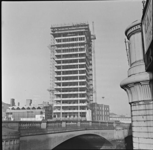 1024px-A_view_from_across_the_River_Liffey_in_Dublin_of_Liberty_Hall_under_construction